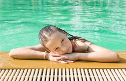Beautiful teen irk relax at poolside in Thailand. Look in camera. Headshot. Beauty, vacation, healthy lifestyle Stock Image