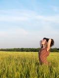 Beautiful Teen Lady Closed Eyes in Field. Beautiful Teen Lady Closed Eyes in Green Field Stock Photo