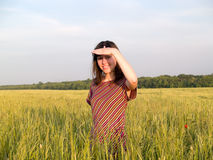 Beautiful Teen Lady Looks in Field Royalty Free Stock Photos