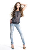 Beautiful teen model in jeans. Portrait of stylish young teen model in fashion jeans with long hair- white background Stock Image