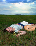 Beautiful teen relaxing in field stock photography