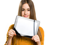 Beautiful teen using tablet computer. Portrait of beautiful brunette teen using tablet computer Stock Images