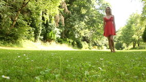 Beautiful teen walking on the grass on a sunny day Royalty Free Stock Photography