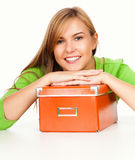 Beautiful teen woman with orange box, smiling Royalty Free Stock Photos