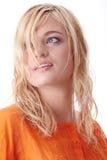 Beautiful teen woman in orange shirt Stock Image