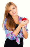 Beautiful teen woman smiling, holding red apple Stock Photos