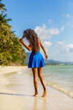 Beautiful teenage black girl in blue skirt on the beach. Royalty Free Stock Photo