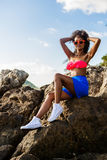 Beautiful teenage black girl in blue skirt and pink bra on the r Royalty Free Stock Photo