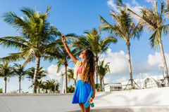 Beautiful teenage black girl in blue skirt take selfie with her Royalty Free Stock Photography