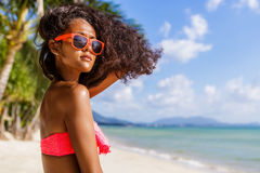 Beautiful teenage black girl with long curly hair in sunglasses. Outdoor lifestyle portrait of black beautiful teenage girl in pink bra and sunglasses. Young Stock Photos