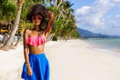 Beautiful teenage black girl in sunglasses, bra and skirt. Royalty Free Stock Image