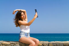 Beautiful teenage brunette teen in jean shorts Stock Photos