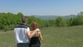 Beautiful teenage couple enjoying nature in a convertible car stock video