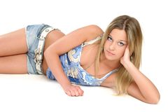 Beautiful teenage girl. With blue eyes and blond hair, isolated on white Stock Photos
