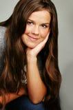 Beautiful Teenage Girl. Beautiful brunette teen on a grey background Stock Images