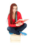 Beautiful teenage girl with african plaits reading Stock Photography