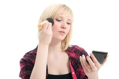 Beautiful teenage girl applying makeup Royalty Free Stock Image