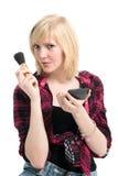 Beautiful teenage girl applying makeup Stock Image