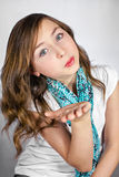Girl blowing a kiss Royalty Free Stock Image