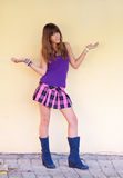 Beautiful teenage girl in boots and short skirt Royalty Free Stock Photography
