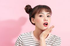 Beautiful teenage girl with buns on a pink background. Beautiful teenage girl with buns on a pink background stock photos