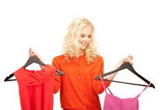 Beautiful teenage girl with clothes Stock Photography