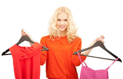 Beautiful teenage girl with clothes Royalty Free Stock Image
