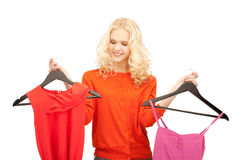 Beautiful teenage girl with clothes Royalty Free Stock Photo