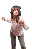 Beautiful teenage girl dances to the music Royalty Free Stock Image