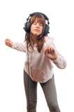 Beautiful teenage girl dances to the music Royalty Free Stock Image