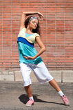 Beautiful teenage girl dancing hip-hop Royalty Free Stock Images