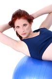 Beautiful Teenage Girl Demonstrating Situp On Exercise Ball Royalty Free Stock Photo