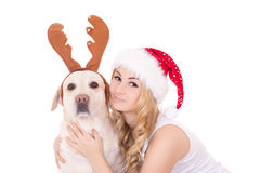 Beautiful teenage girl with dog in reindeer horns isolated on wh Royalty Free Stock Photos