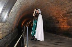 A teenage girl in the Templars tunnel in Akko, Israel. A beautiful teenage girl dressed as a Templar in the Templars Tunnel in Akko, Israel stock photos