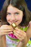 Beautiful teenage girl eating chocolate Royalty Free Stock Photography