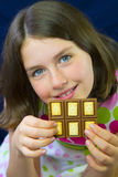 Beautiful teenage girl eating chocolate Royalty Free Stock Images