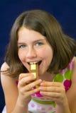 Beautiful teenage girl eating chocolate Stock Photos
