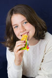 Beautiful teenage girl eating energy bar Stock Images