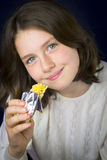 Beautiful teenage girl eating energy bar Stock Photo