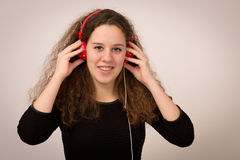 Beautiful Teenage Girl Enjoying Music On Headphones Stock Images