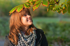 Beautiful teenage girl enjoying sunny autumn day Stock Images