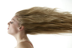 Beautiful teenage girl with extreme blowing hair Royalty Free Stock Photos