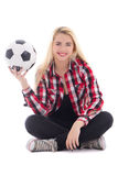 Beautiful teenage girl in eyeglasses sitting with soccer ball is Stock Photo