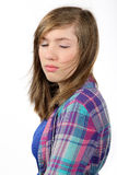 Beautiful teenage girl with eyes closed and flying hair Stock Photos