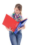 Beautiful teenage girl with folders isolated over white Stock Photos