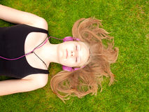 Beautiful Teenage Girl with headphones lying on her back Stock Photography