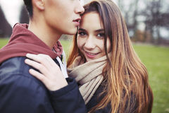 Beautiful teenage girl with her boyfriend in park Stock Photography