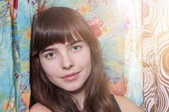 Beautiful teenage girl and her wardrobe Stock Photo
