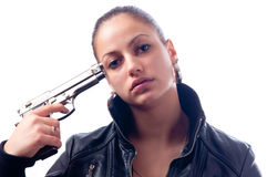 Beautiful teenage girl holding gun to her head Royalty Free Stock Image