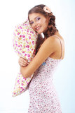 Girl holding pillow Stock Photos